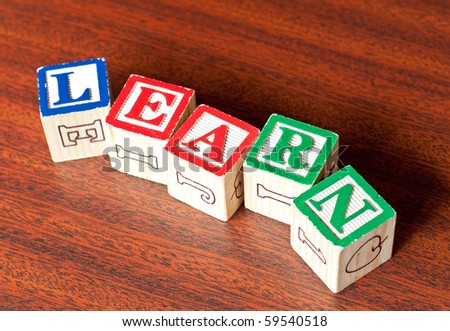 Learn Spelled Out on Mahogany Wood - stock photo