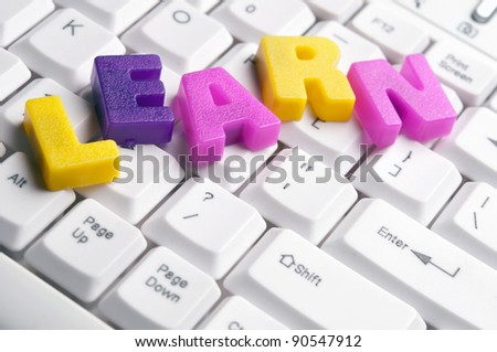 Learn word made by colorful letters on keyboard - stock photo