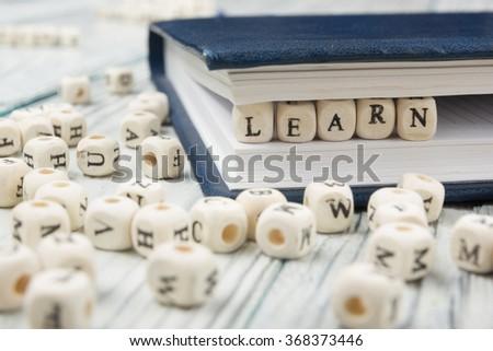 LEARN word written on wood block - stock photo