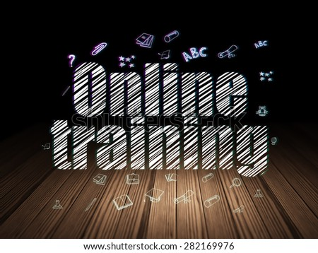 Learning concept: Glowing text Online Training,  Hand Drawn Education Icons in grunge dark room with Wooden Floor, black background, 3d render - stock photo