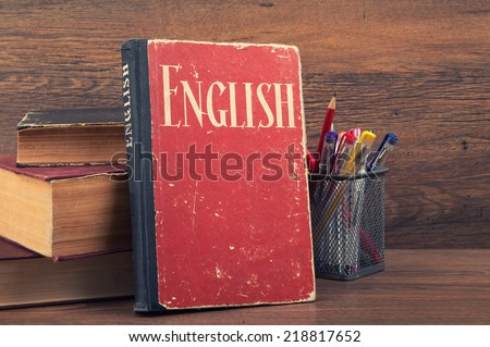 learning english concept. book on a wooden background - stock photo