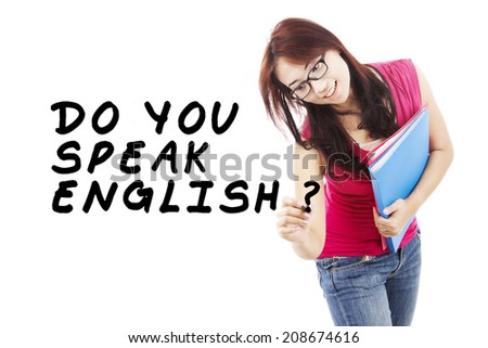 Learning language concept. Female student write Do You Speak English? - stock photo