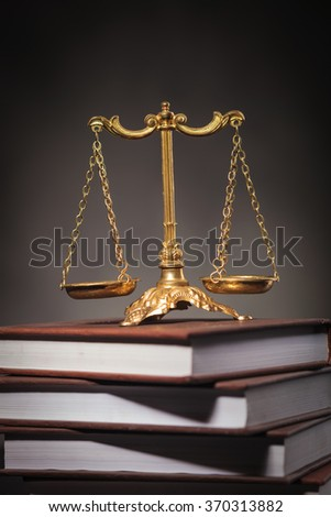 learning law concept, golden scale on a pile of books , studio picture - stock photo