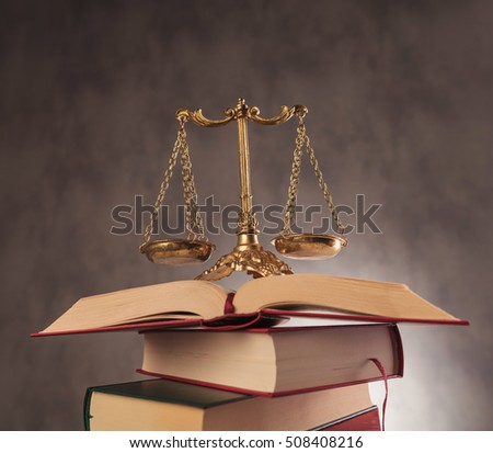learning to be fair in all decisions. antique scale on top of a pile of books, studying law concept