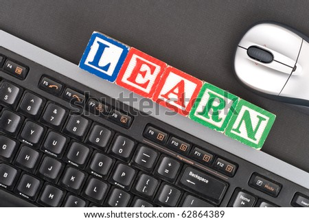 Learning to Use the Computer - stock photo
