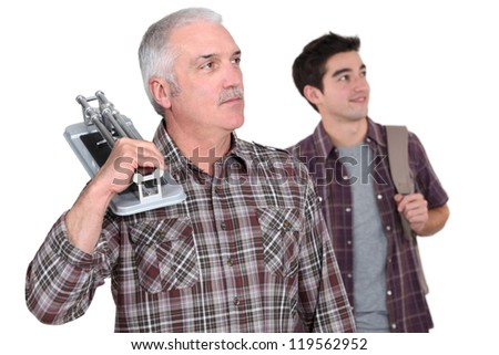 Learning with experienced tiler - stock photo