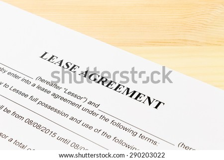 Lease Agreement Contract Document on Wood Table Left Angle View. Legal document for business event - stock photo