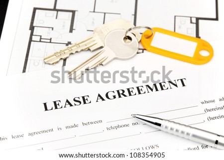 Lease agreement document with keys and pen