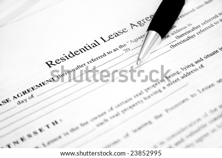Lease agreement with pen. Used selective focus and shallow Depth of field.