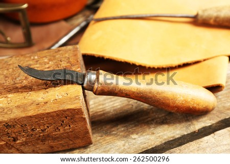 Leather and craft tools on table close up - stock photo