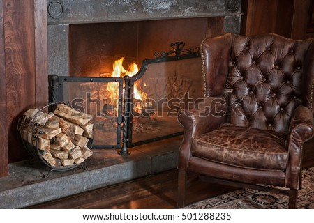 Exceptionnel Leather Armchair In Retro Style Near The Fireplace