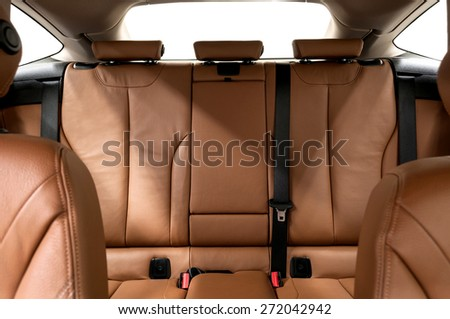 Leather back passenger seats in modern car. Interior detail. - stock photo