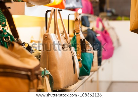 Leather bags in a shop waiting for customers - stock photo