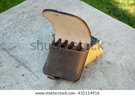 Leather bandoleer of ammunition with the application of antelope - stock photo