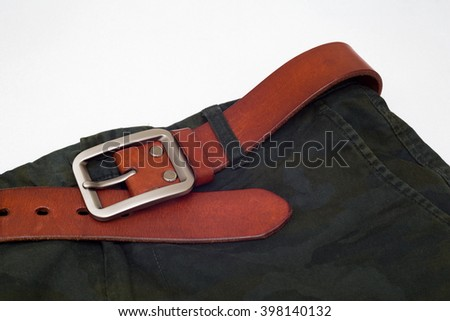 Leather belt and Camouflage pants on white background