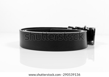 Leather belt closeup on white background,black and white concept. - stock photo