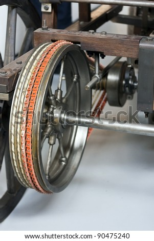 Leather belt drive of very old wooden car - stock photo