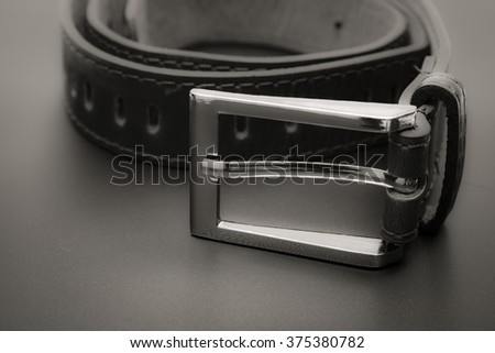 Leather belt for men1.strap close up,white background,men accessory,belt for trousers - stock photo