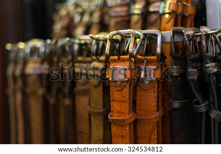 Leather belts collection in the store. - stock photo