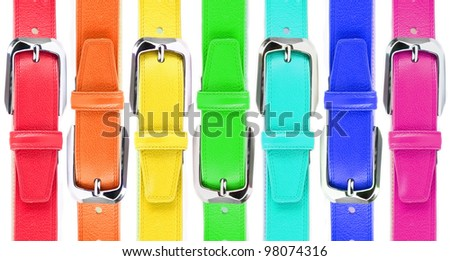 Leather belts of all colors of a rainbow - stock photo