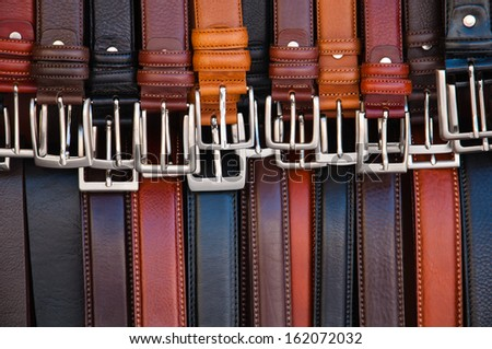 leather belts on display - stock photo