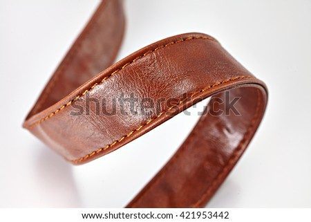 Leather belts on white background - stock photo