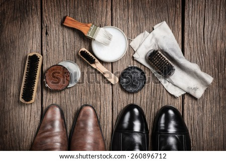 leather boots with shoe maintenance set - stock photo