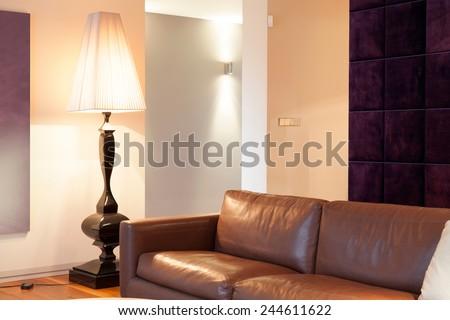 Leather brown sofa inside expensive house, horizontal - stock photo