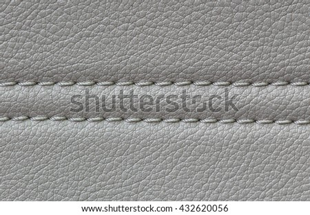leather car upholstery, beige color - stock photo