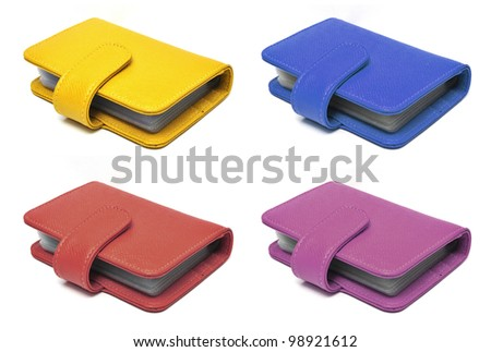 Leather cards holder collection on a white background - stock photo