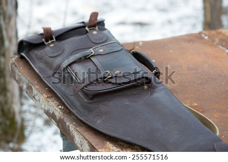 Leather case for rifle outdoors during hunting - stock photo
