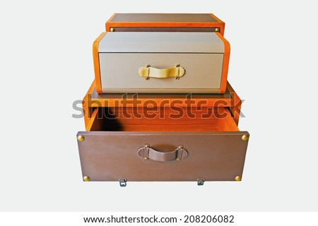 leather-covered wooden drawer on white background - stock photo