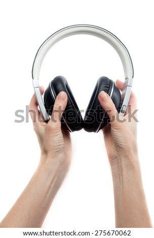 Leather earphones in female hands. Isolate on white. - stock photo