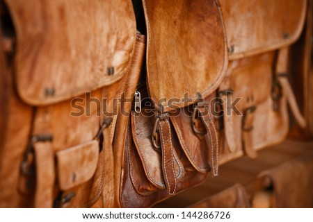 Leather goods - handbags in the open market - stock photo