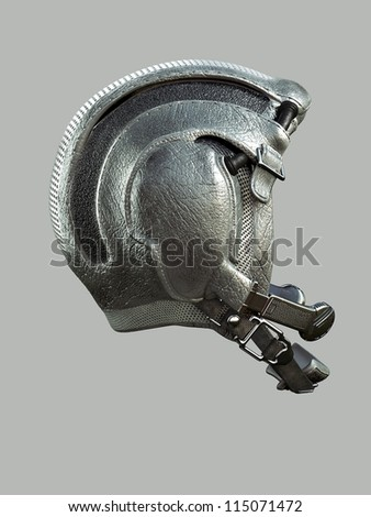 leather helmet astronaut on a gray background with a radio transmitter and a strap under the chin - stock photo