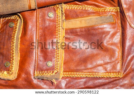 Leather Jacket texture, background with decorative stripes. an outer garment extending either to the waist or the hips, - stock photo