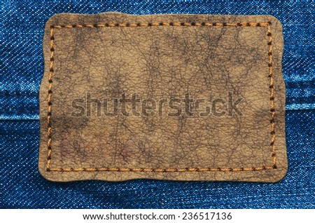 Leather jeans label sewed on jeans. - stock photo
