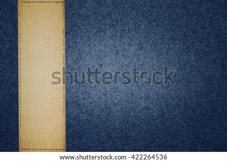 leather label and blue jean texture background - stock photo