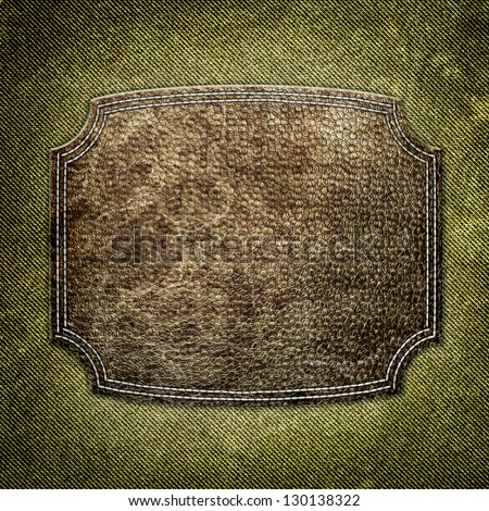 Leather label on fabric - stock photo