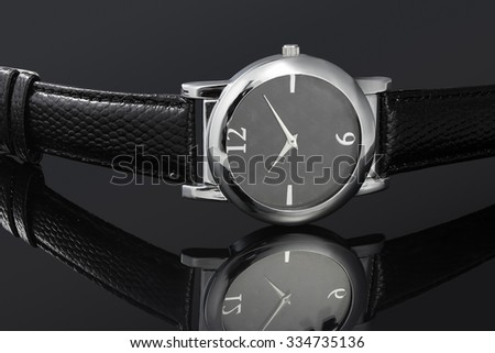 Leather ladies watch on black background - stock photo