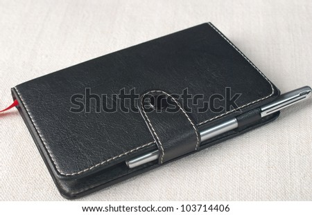 Leather notebook and pen on the table - stock photo