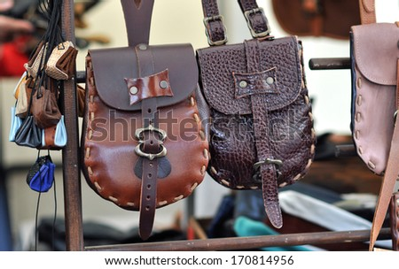 leather pouch on the market - stock photo
