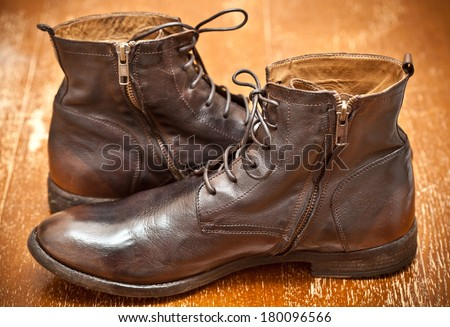 Leather shoes brown. Fashionable leather high boots. autumn - spring shoes. cowboy style. Aged leather boots. Vintage style - stock photo