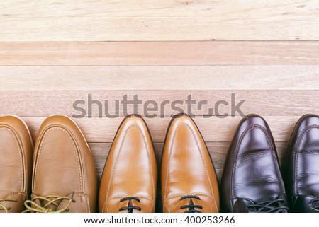 Leather Shoes on wood Background, Men fashion - stock photo