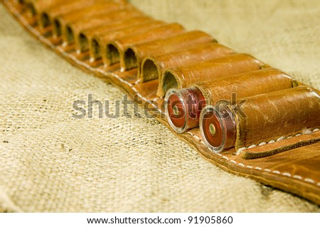 leather shotgun cartridge belt on hessian