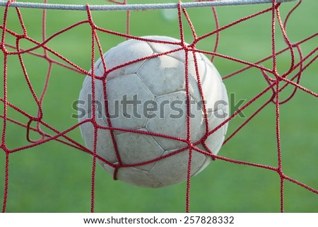 leather soccer ball in the net