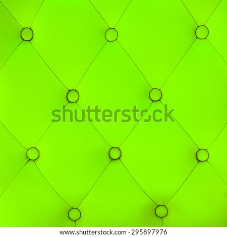 leather sofa color green background - stock photo