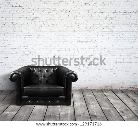 leather sofa in brick room - stock photo