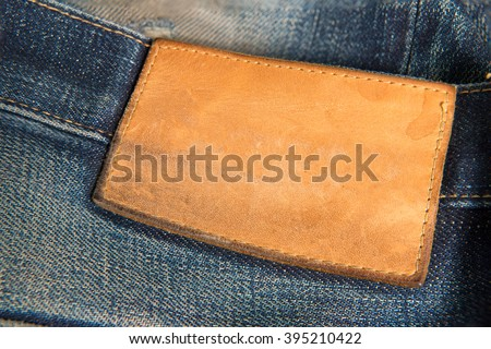 Leather tag on jeans - stock photo