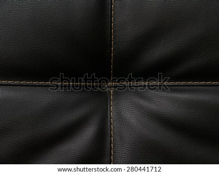 Leather texture close-up with linear stitches - stock photo